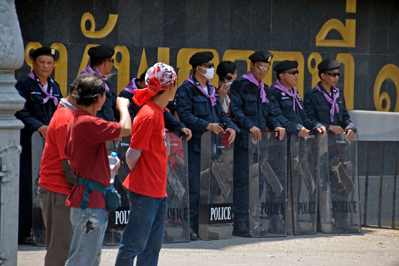 Protesters and riot police during Red Shirt Protest - Thailand