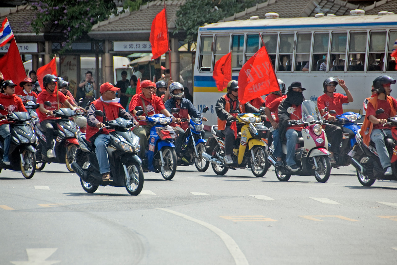 Protesters wearing red shirt and riding motorcycles - Thailand
