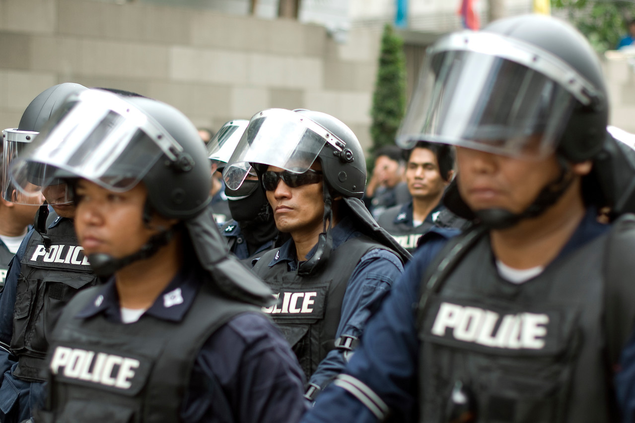 Closer shot of riot police wearing battle gear - Thailand