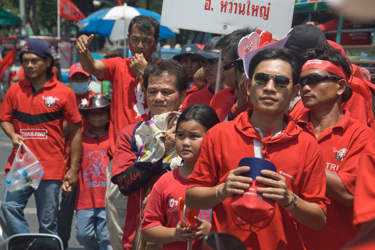 Protesters with kids at the Red Shirt Rally in Thailand