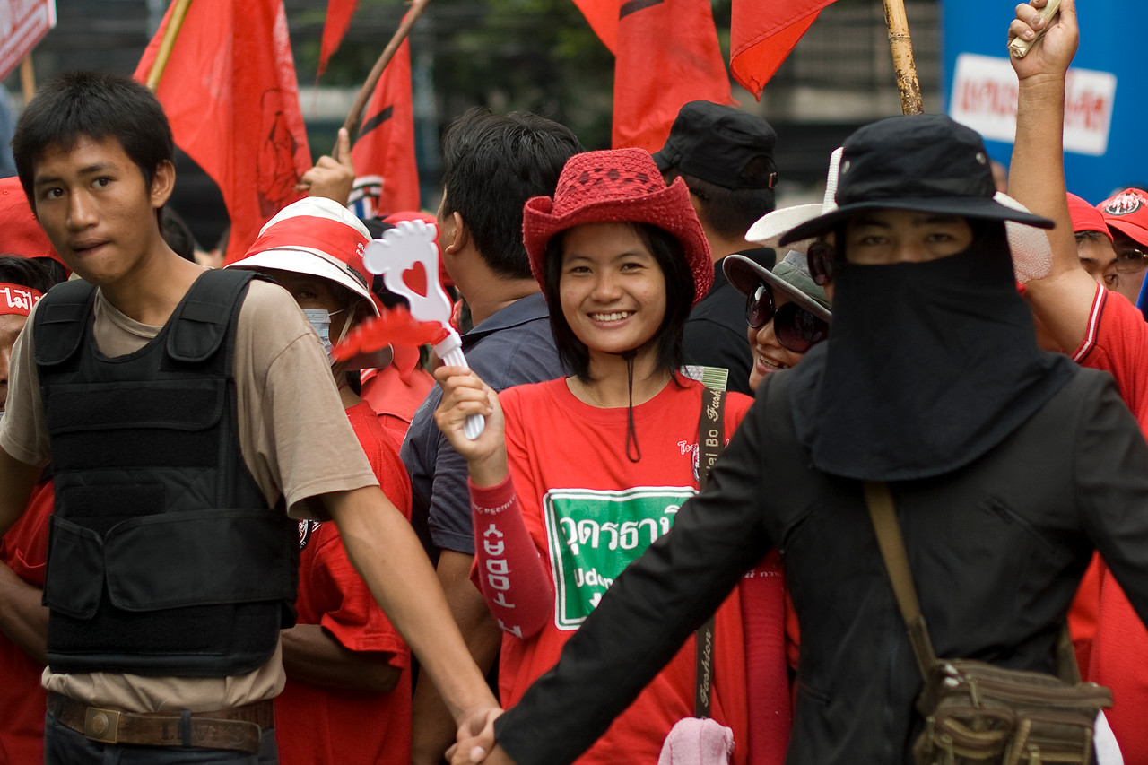 Woman smiling to the camera during Red Shirt Protest - Thailand