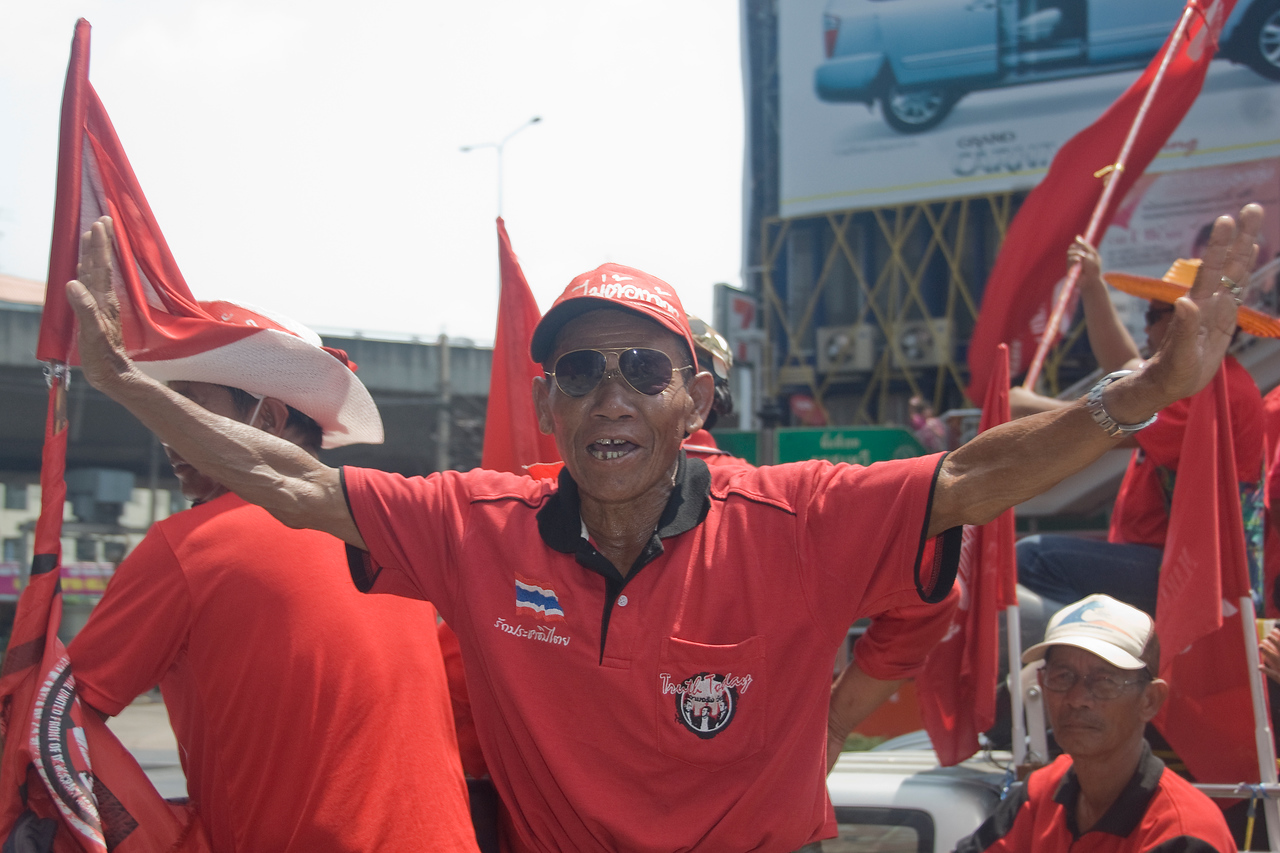 Man posing for the camera during Red Shirt Protest in Thailand