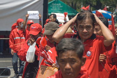 Protesters being showered on during Red Shirt Protest in Thailand