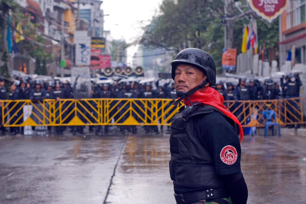 Red Shirt protester staring down police - Bangkok, Thailand