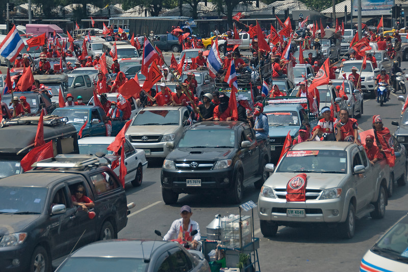 Protesters riding vehicles during Red Shirt Protest in Thailand
