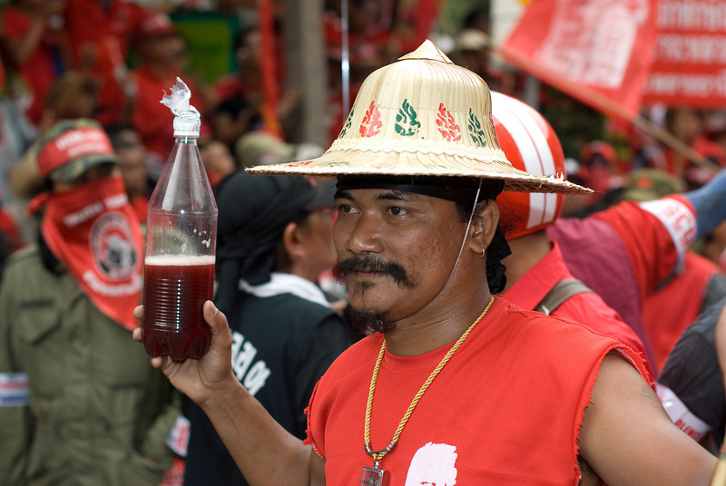 Man posing for the camera at the Red Shirt Protest in Thailand