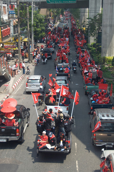 Protesters waving out flags from back of truck during Red Shirt Protest
