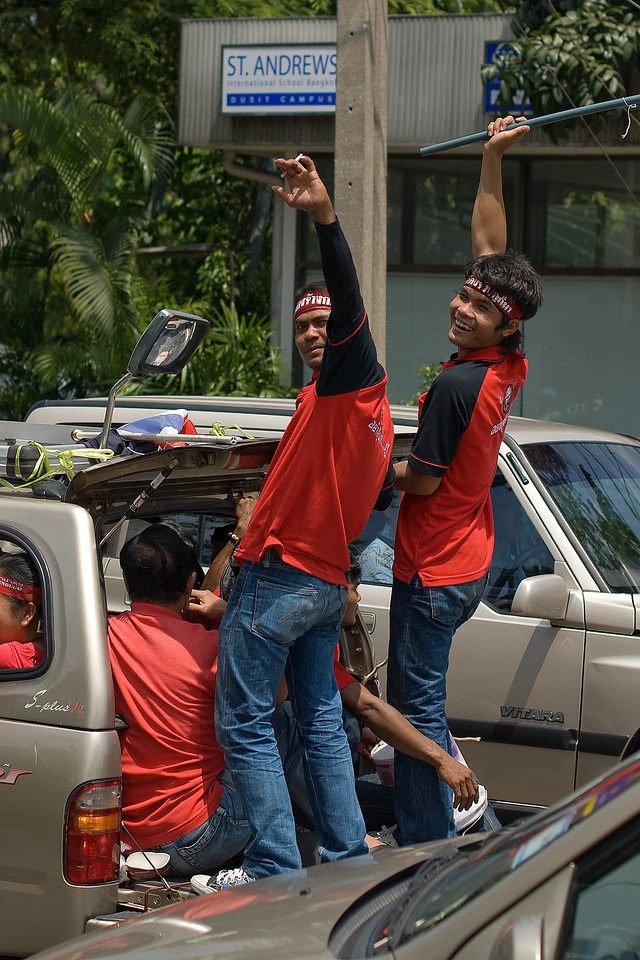 Male protesters at the back of a truck in Thailand