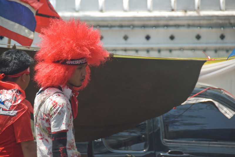 Man wearing red full wig during Red Shirt Protest - Thailand