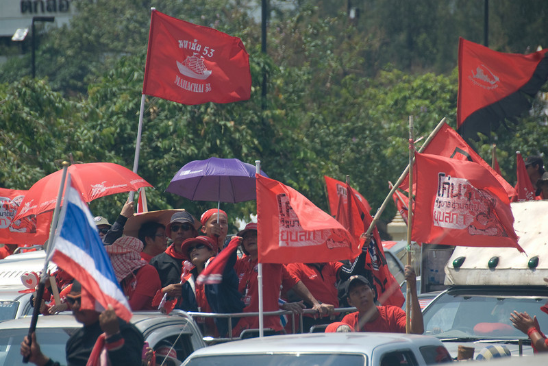 Flags waving from the back of a truck during Red Shirt Protest in Thailand