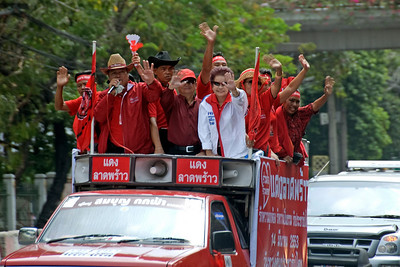 Protesters riding on the back of a truck during Red Shirt Protest in Thailand