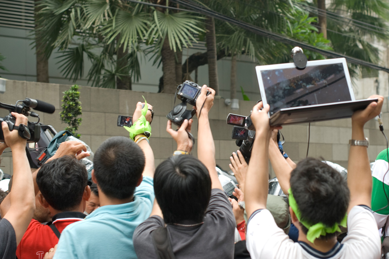 Media people covering an interview during Red Shirt Protest