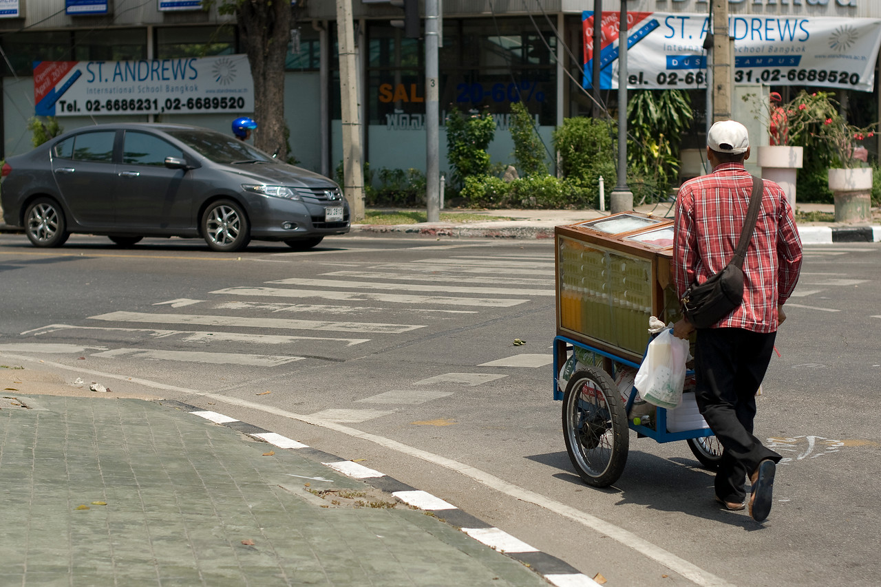 Man peddling drinks during Red Shirt Protest in Thailand