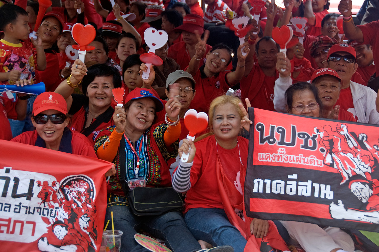 Women smiling to camera during Red Shirt Protest - Thailand