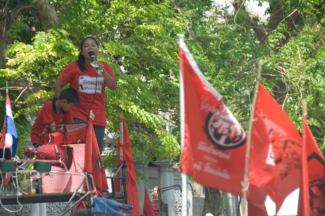 Woman speaking to mic during Red Shirt Protest in Thailand