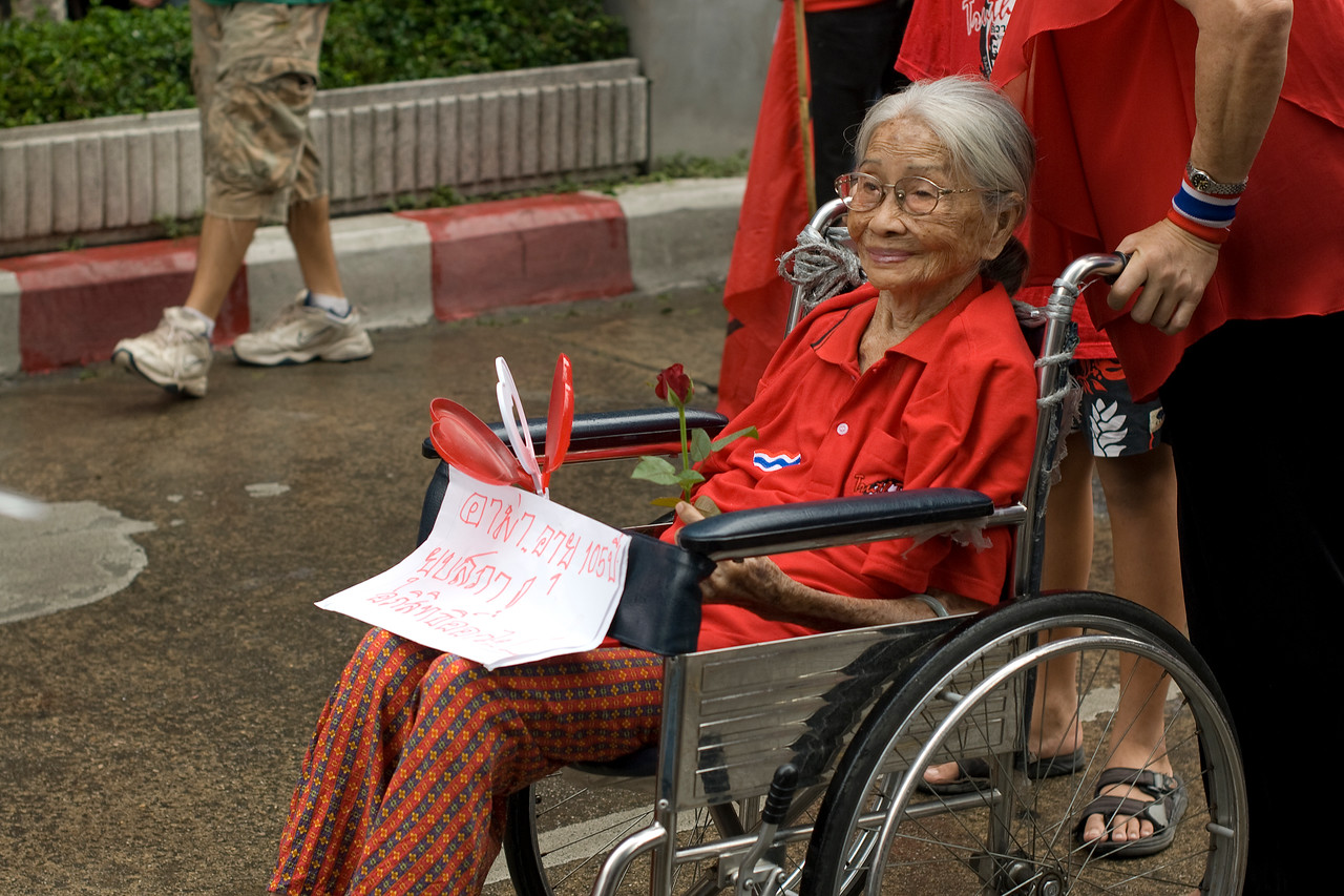 Woman on wheelchair joining the Red Shirt Protest - Bangkok, Thailand