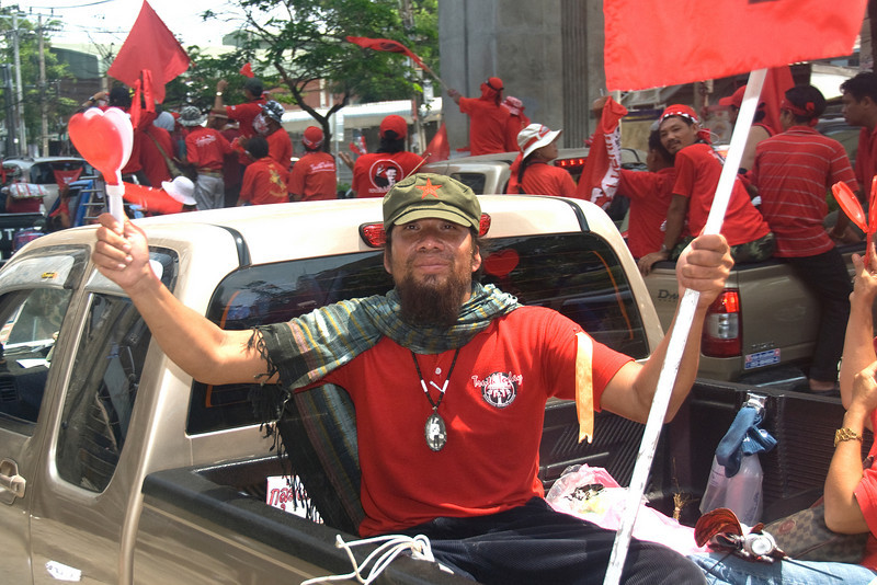 Man on the back of a truck during Red Shirt Protest in Thailand