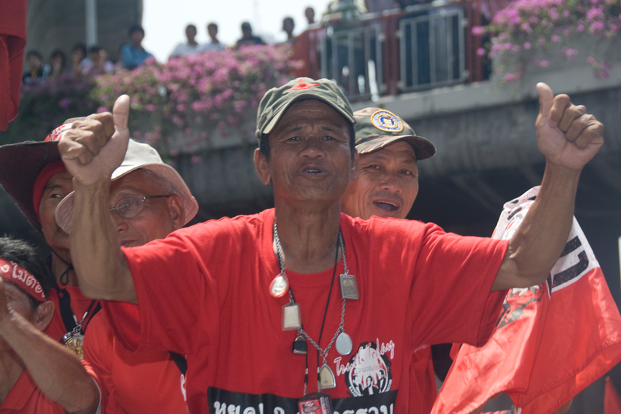 Men cheering during Red Shirt Protest in Thailand