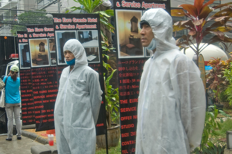 Men wearing rain suit at the Red Shirt Protest