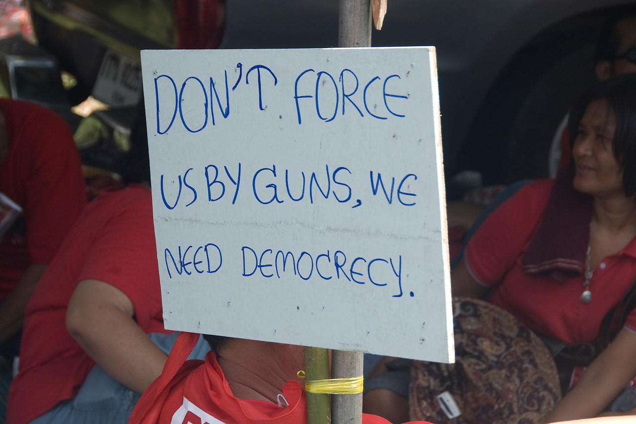 Protest sign with a message to the Thai government