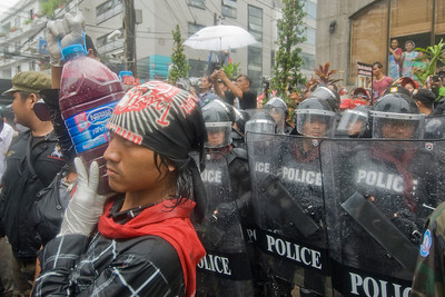 Protesters surrounded by riot police in Thailand