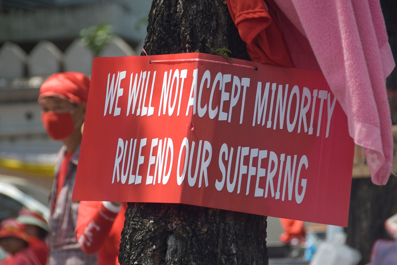 Protest sign on a tree during Red Shirt Protest - Thailand