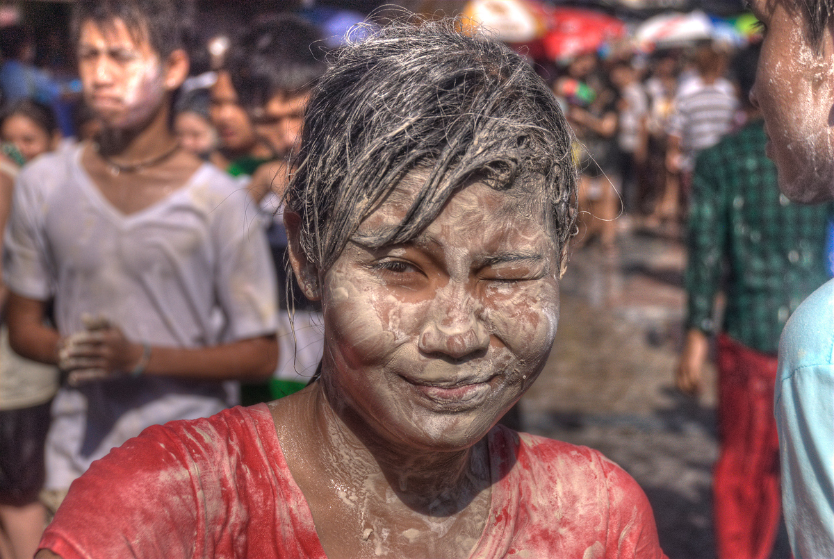 Boy with talcum power during Songkran, Bangkok, Thailand