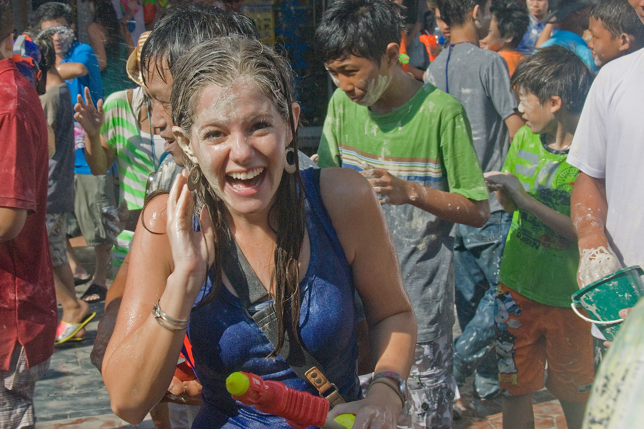 Woman smiles to the camera at the 2010 Songkran Festival