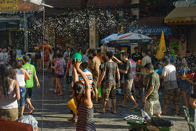Water flung into the air from a bucket - 2010 Songkran Festival