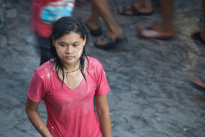 A woman drenched and sprayed with paint during 2010 Songkran Festival