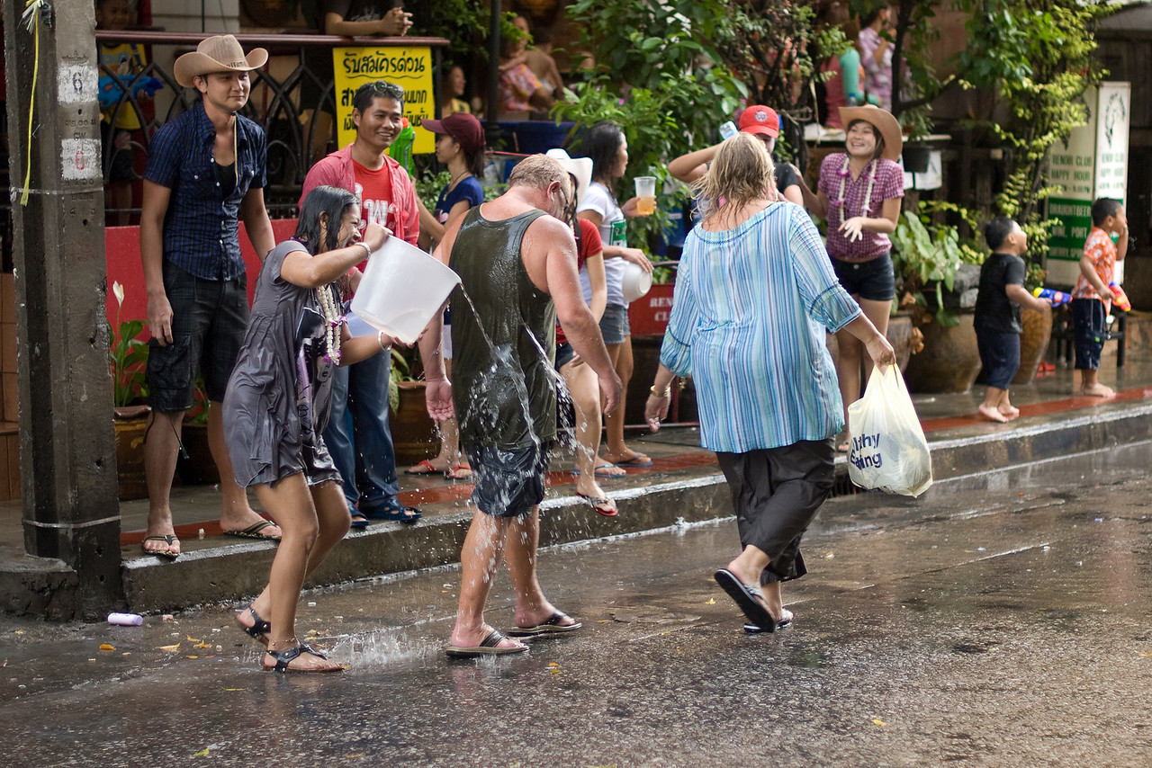 Same set of tourists getting more water from onlookers during the Songkran Festival
