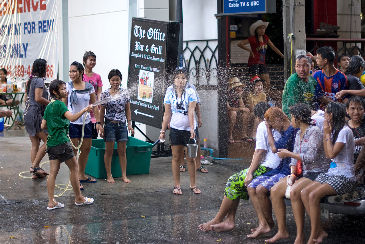 Girl spraying on water from hose in  Thailand's Songkran Festival