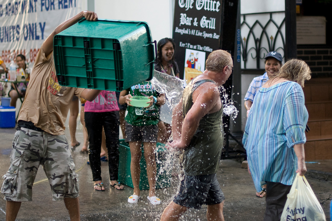 Tourists being poured onto with water at the Songkran Festival