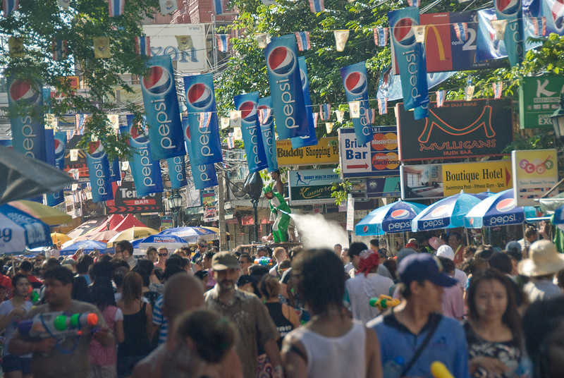 Soda company banners hung above the crowd in 2010 Songkran Festival