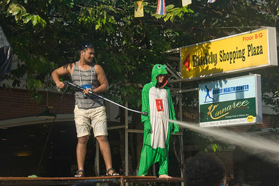 Man showering water onto the crowd during the 2010 Songkran Festival