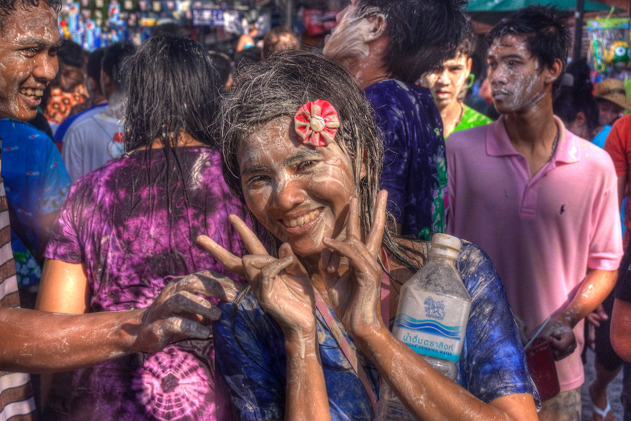 Woman playfully smiles to the camera during Songkra Festival in Thailand