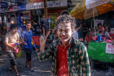 Man gamely smiles to the camera during Songkra Festival
