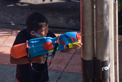 Boy shoots water from a toy gun in the 2010 Songkran Festival