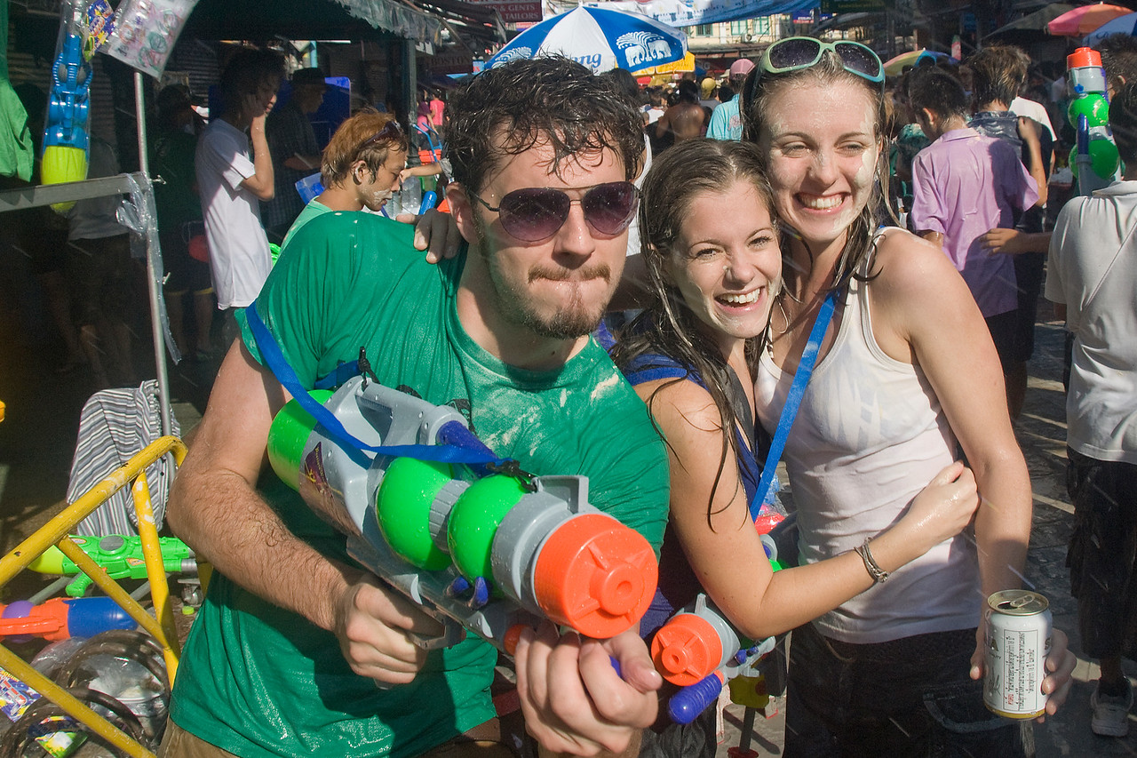 Tourists playing around in front of camera at the 2010 Songkran Festival