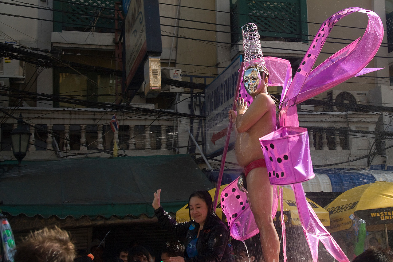 Man in funny costume getting splashed with water in the 2010 Songkran Festival