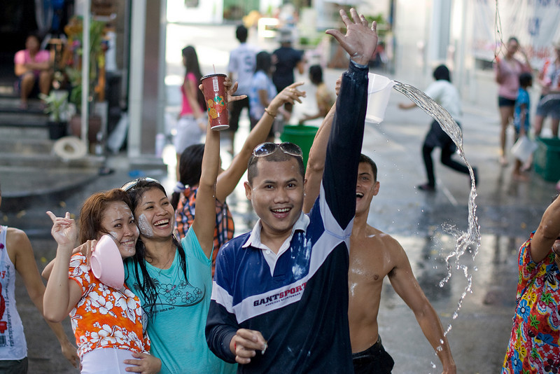 Locals wave to the camera during the 2010 Songkran Festival