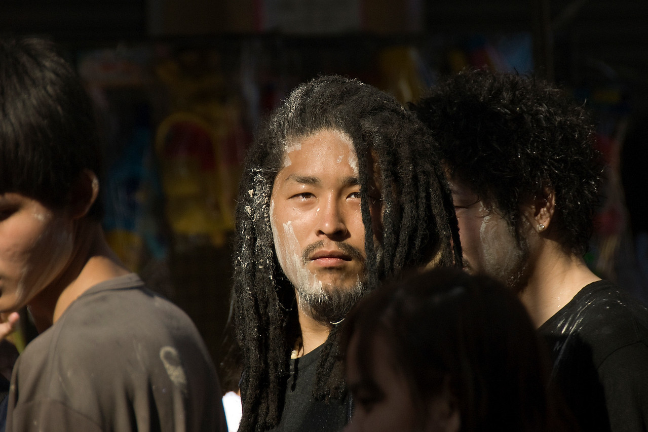 Man in dreadlocks with paint on face