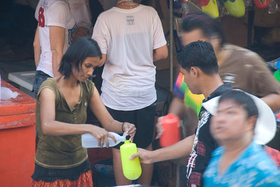 Collecting water into bottles during the 2010 Songkran Festival