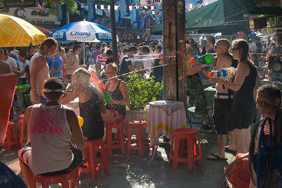 Tourists shooting water guns on each other during Songkran Festival