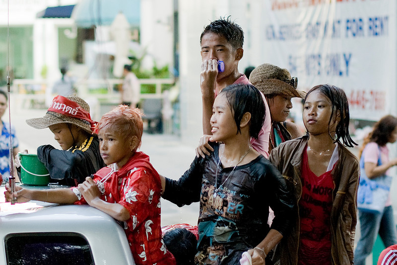 Kids drenched from the back of a pickup truck at the 2010 Songkran Festival