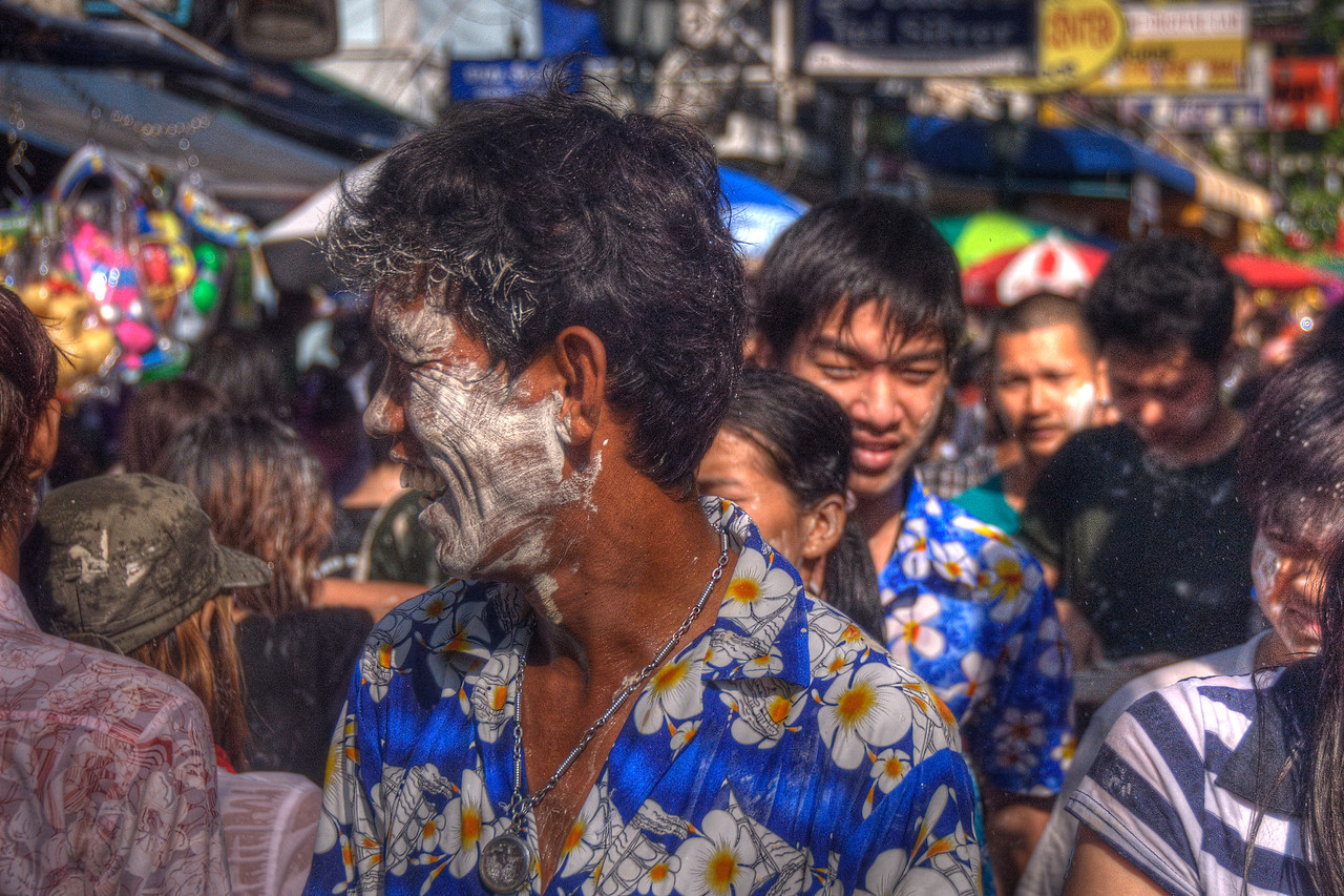 Man with paint on face during Songkran Festival in Thailand