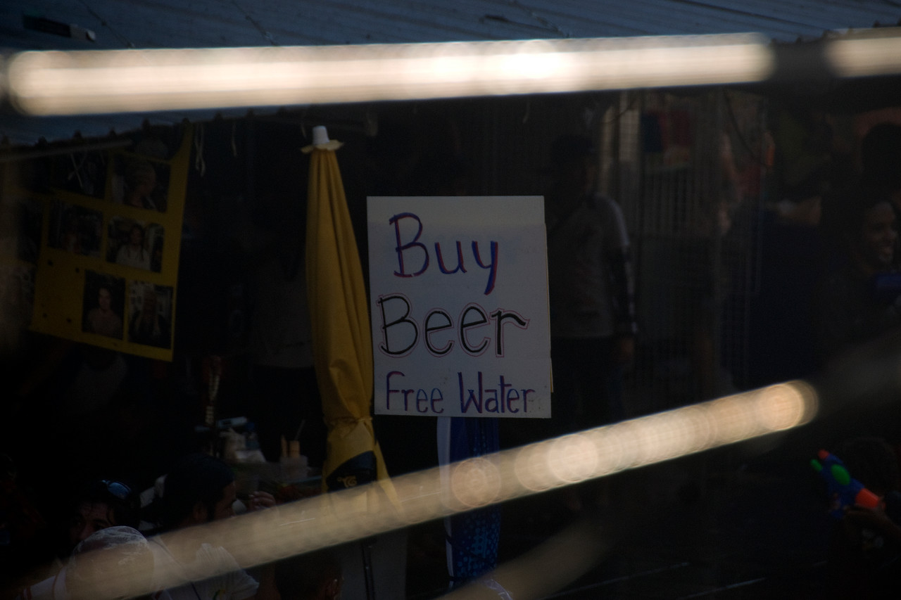 """Buy Beer, Free Water"" sign at a stall in the 2010 Songkran Festival"