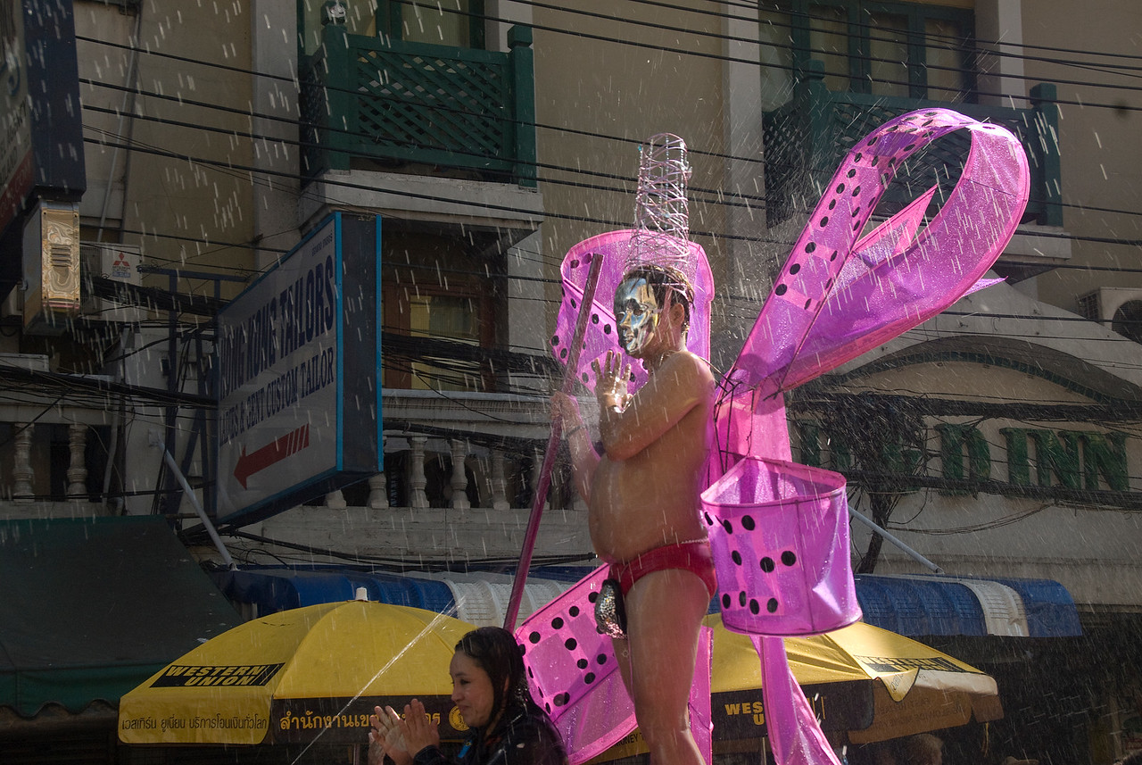 Man in funny costume parading at the 2010 Songkran Festival