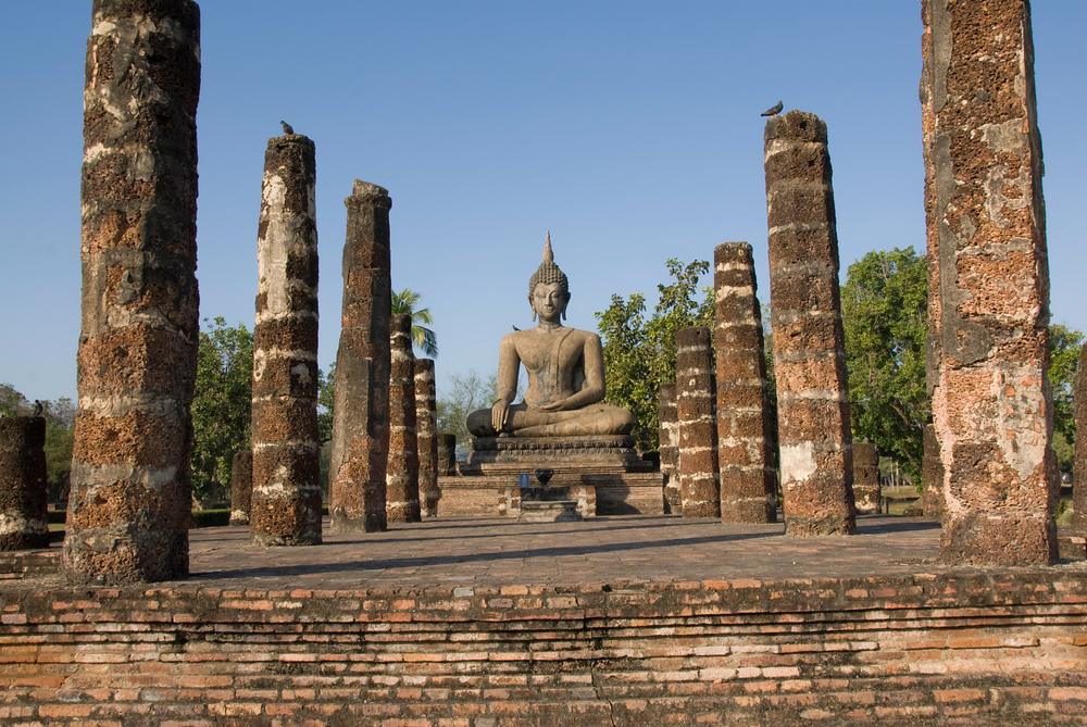 Buddha in ruins of Wat Mahathat, Sukhothai, Thailand