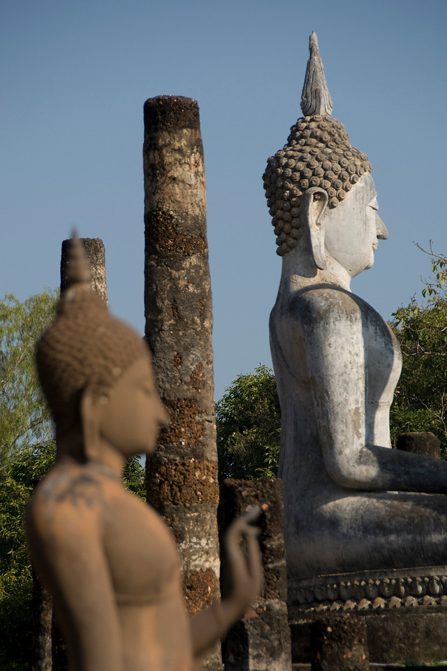 Closer shot of Buddha statues in Wat Sa Si - Sukhothai, Thailand